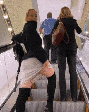 Kinky girlfriend flashes her ass on an escalator