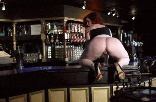 Redhead Bartender shows her big Butt on the counter